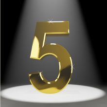 A golden number five in a spot light
