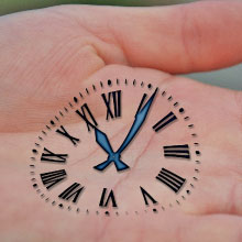 Image of a clock on a hand
