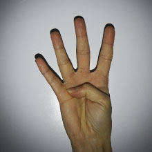 Hand holding up four fingers