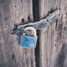 Padlock on old barn door