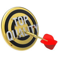 Red dart on a gold target with text on it saying top quality