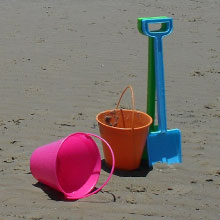 Sand buckets and shovels on a beach