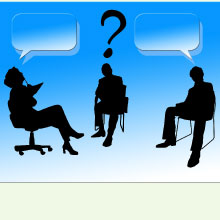Silhouettes of an interview - question mark floating over head