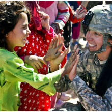 Soilder greeting a child