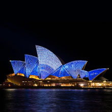 Sydney Operah House in Austrailia at night from harbour
