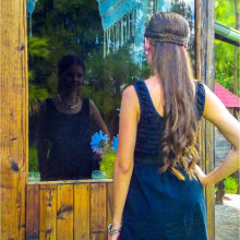 A women looking at her reflection in window